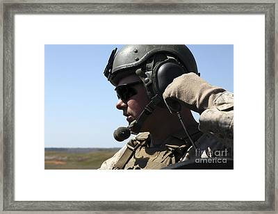 A Soldier Keeps In Radio Contact Framed Print by Stocktrek Images