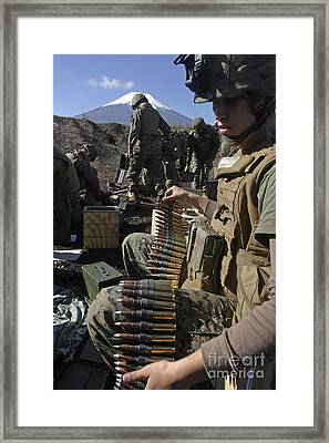 A Soldier Links .50 Caliber Rounds Framed Print