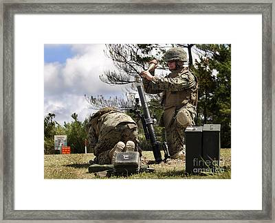 A Soldier Loads A High Explosive Mortar Framed Print