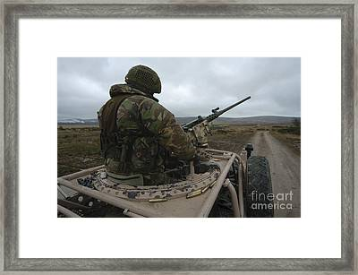 A Soldier Mans A .50 Caliber Machine Framed Print by Andrew Chittock
