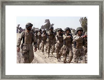 A Soldier Marches His Troops Framed Print by Stocktrek Images