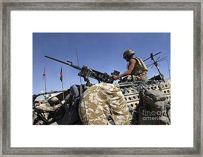 A Soldier Of The British Army Mans Framed Print by Andrew Chittock