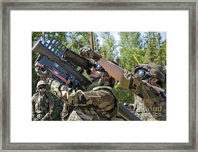 A Soldier Operates A Missile Launcher Framed Print by Stocktrek Images