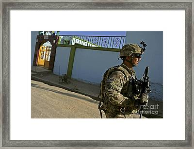 A Soldier Patrols The Streets Of Qalat Framed Print