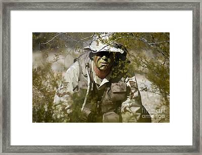 A Soldier Practices Evasion Maneuvers Framed Print by Stocktrek Images