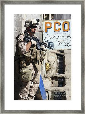 A Soldier Provides Security Framed Print by Stocktrek Images