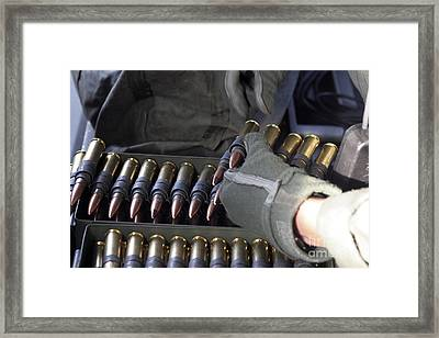 A Soldier Reaches For A Belt Of .50 Framed Print by Stocktrek Images