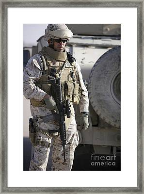 A Soldier Stands Alert As He Provides Framed Print by Stocktrek Images