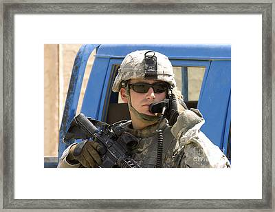 A Soldier Talking Via Radio Framed Print by Stocktrek Images