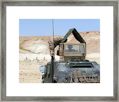 A Soldiier Instructs An Iraqi Army Framed Print by Stocktrek Images