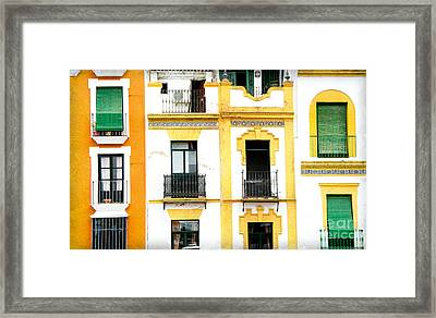A Spanish Facade Framed Print by Perry Van Munster