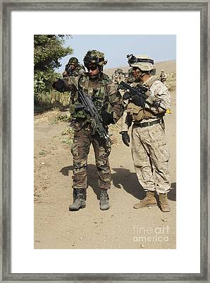 A Spanish Marine Points Out An Framed Print by Stocktrek Images