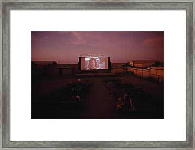 A Sparse Audience Watches A Film Framed Print by Sam Abell
