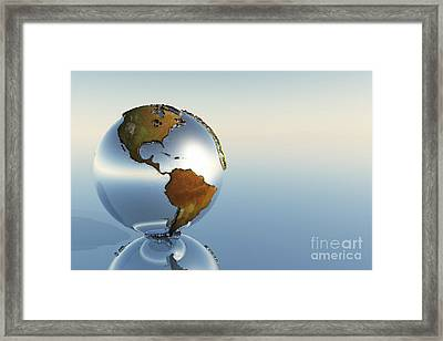 A Sphere Holding North And South Framed Print by Corey Ford