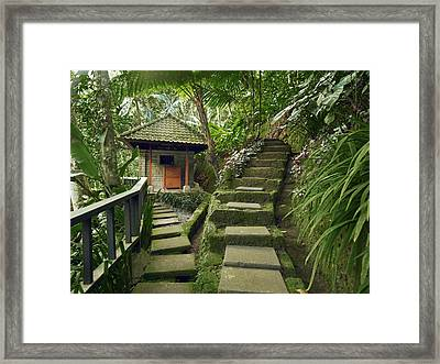 A Square Stone Pathway Leads To A Small Framed Print by Justin Guariglia