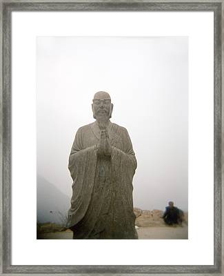A Statue Of A Buddhist Monk In China Framed Print by Justin Guariglia