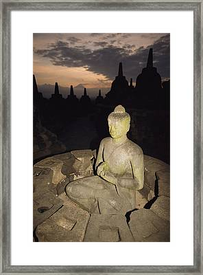 A Statue Of Buddha,  Borobudur, Java Framed Print by Paul Chesley
