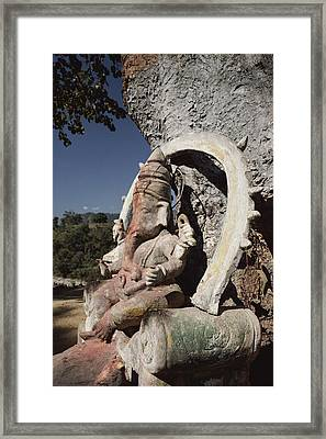 A Stone Sculpture Shrine To The Hindu Framed Print by Gordon Wiltsie