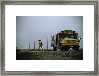 A Student Heads Home After The Journey Framed Print by Joel Sartore