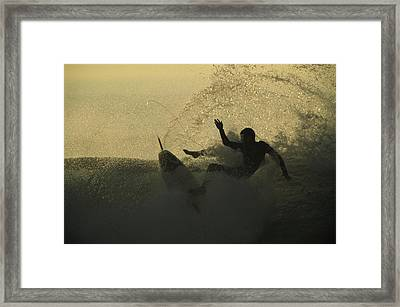 A Surfer Wipes Out On A Breaking Wave Framed Print by Tim Laman