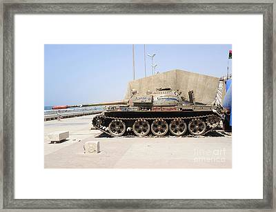 A T-55 Tank On The Seafront Framed Print by Andrew Chittock