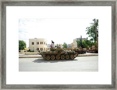 A T-72 Main Battle Tank On The Streets Framed Print by Andrew Chittock