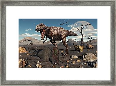 A T. Rex Is About To Make A Meal Framed Print by Mark Stevenson