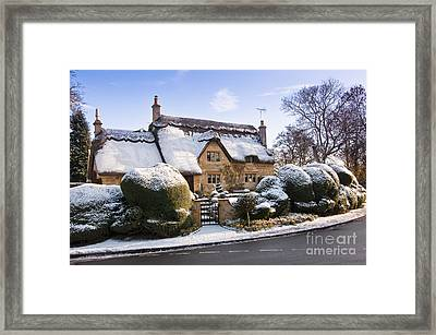 A Thatched Cottage In The Cotswolds  Framed Print by Andrew  Michael