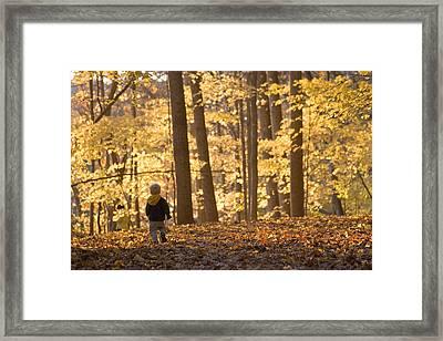 A Three Year Old Boy Walks Framed Print by Skip Brown