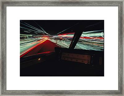 A Time Exposure Showing Streaks Framed Print by Paul Chesley