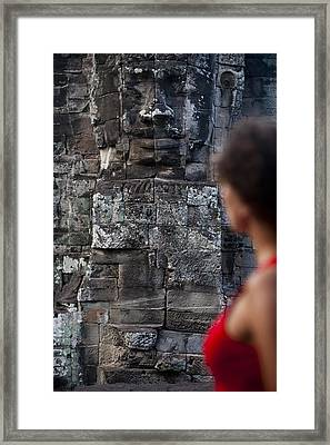 A Tourist Gazes At One Of The Enigmatic Framed Print by Alex Treadway