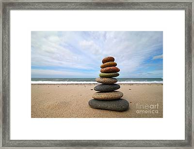 A Tower Of Stones On The Beach Framed Print by Holger Ostwald