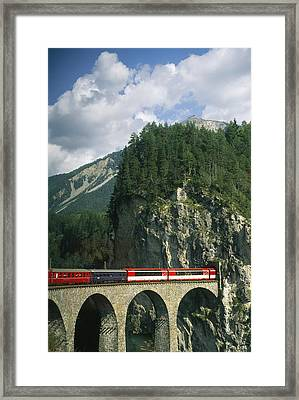 A Train Passes Into A Framed Print by Taylor S. Kennedy