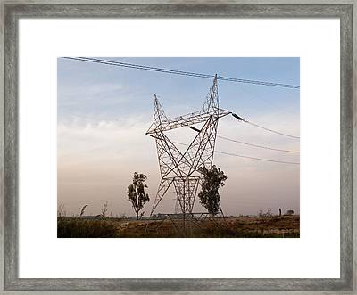 Framed Print featuring the photograph A Transmission Tower Carrying Electric Lines In The Countryside by Ashish Agarwal