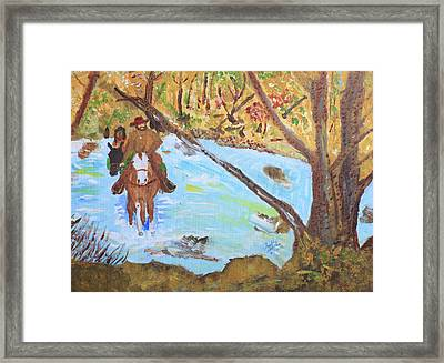 A Trapper And His Indian Lady Crossing A Stream Framed Print