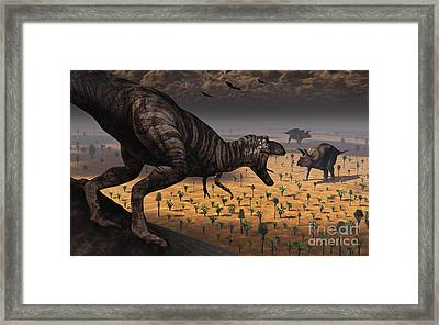 A Tyrannosaurus Rex Spots Two Passing Framed Print by Mark Stevenson