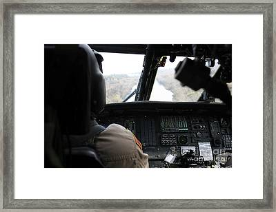 A Uh-60 Blackhawk Flies The River To An Framed Print by Terry Moore