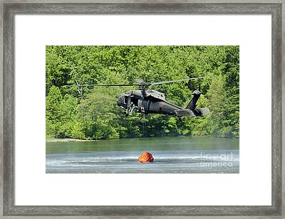 A Uh-60 Blackhawk Helicopter Fills Framed Print by Stocktrek Images