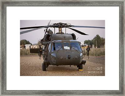 A Uh-60l Black Hawk With Twin M240g Framed Print by Terry Moore