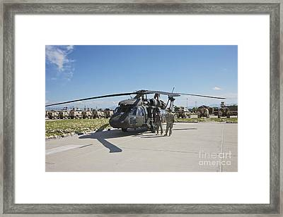 A Uh-60l Blackhawk Parked On Its Pad Framed Print by Terry Moore
