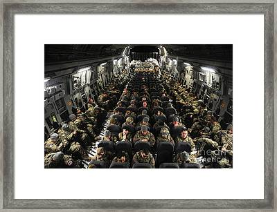 A Unit Of U.s. Army Soldiers In A C-17 Framed Print by Stocktrek Images