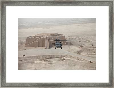 A Us Army Black Hawk Helicopter Hovers Framed Print by Everett
