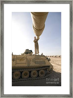 A Us Army Mechanic Uses A M113 Framed Print by Terry Moore