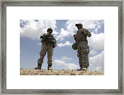 A U.s. Army Soldier Communicates Framed Print by Stocktrek Images