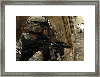 A U.s. Army Soldier Providing Security Framed Print