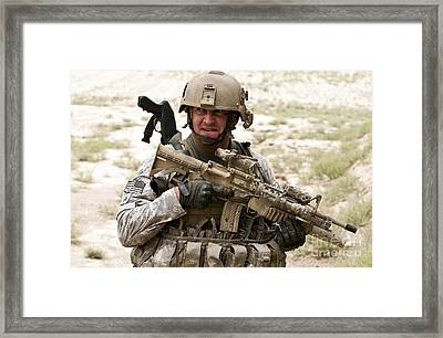 A U.s. Army Soldier Secures Framed Print