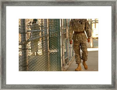 A U.s. Army Soldier Stands Guard Framed Print by Everett