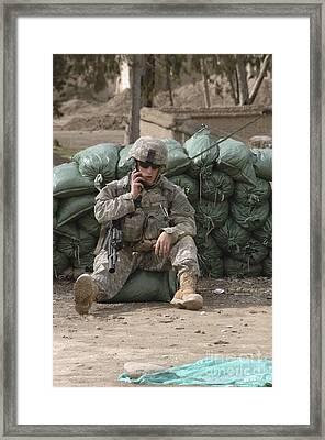 A U.s. Army Soldier Talks On A Radio Framed Print by Stocktrek Images