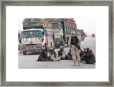 A U.s. Army Soldier With Afghani Men Framed Print by Everett