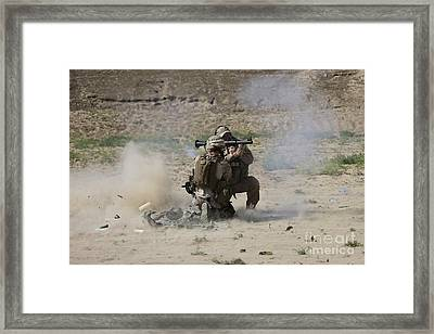 A U.s. Contractor Fires Framed Print